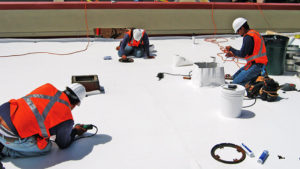 Roofers working in a roof